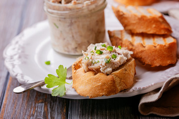 Pieces of fried bread with fish pate