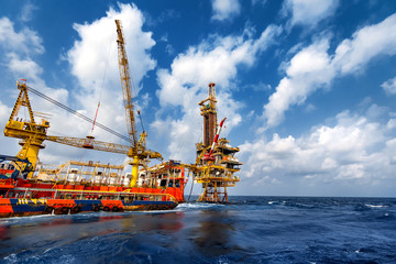 Technician or worker on the crew boat during transfer to platform or drilling rig  in process oil and gas platform offshore,technician