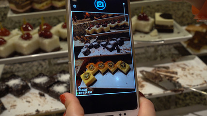 Take sweets food image with smartphone, top view.