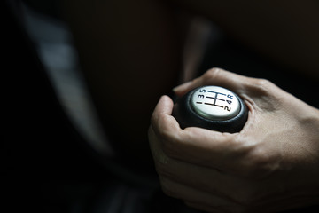 close up hand with manual gear shift lever, car transportation concept