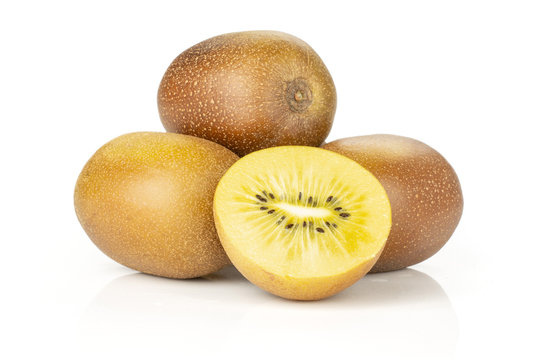 Lot of whole one half of fresh golden brown kiwi fruit sungold variety stack isolated on white