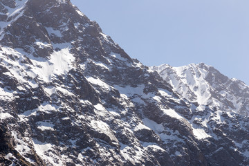 Beautiful view of mountains in snow at Triund hill top, Snow Line, Mcleod ganj, Dharamsala, India.