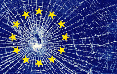 european union flag on the surface of broken glass symbolizes the crisis and the threat of disintegration of the European Union