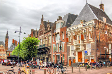 HAARLEM, NETHERLANDS - JULY 09, 2018 : Historical houses in old Haarlem. Typical Dutch architecture.