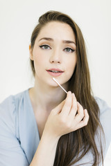 Woman holding cotton bud