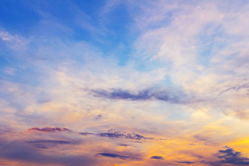Colorful dramatic sky with clouds at sunset