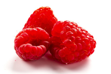 ripe raspberry on white background close up