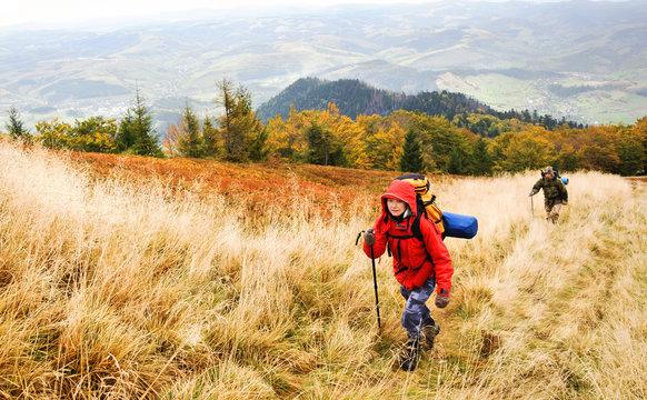 Hiking in autumn mountains