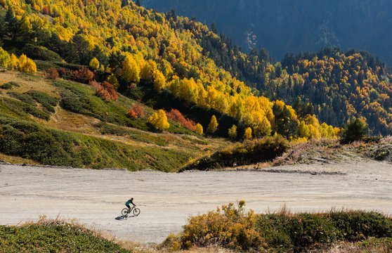 Mountain biker riding on bike in  mountains landscape
