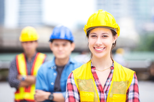 Young female engineer smile and stand with success engineer team