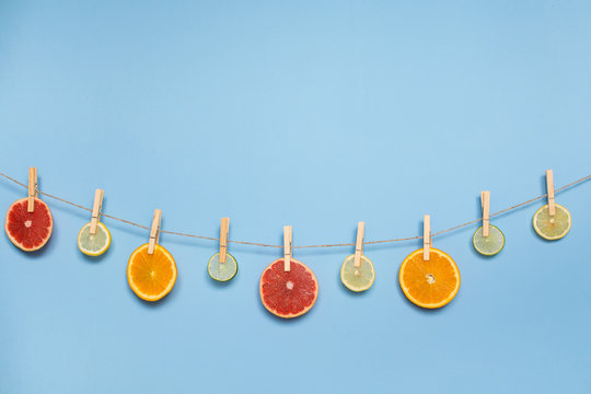 Slices of orange, grapefruit, lemon and lime hanging on a rope