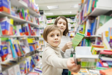 girls  choosing   books in   bookstore for school