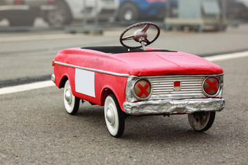Children's retro toy of the times of the USSR. Toy car on pedals