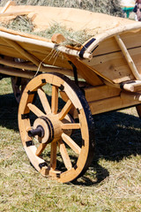 Wooden cart with hay for decor during traditional harvest fair