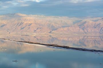 Sunset over lowest salty lake in world below sea level Dead sea, Israel and Jordan