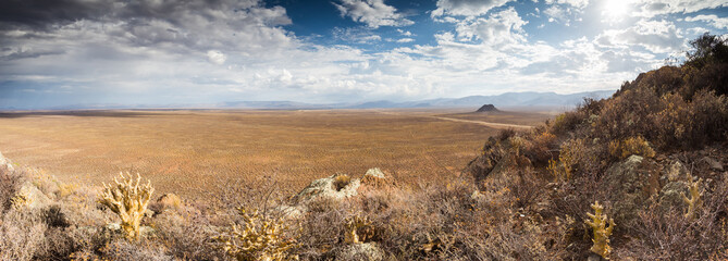 Panoramic views over the Tankwa Karoo Desert with dramatic thunderclouds in the sky