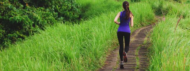 Slim girl in tight sportswear running outdoors Wall mural