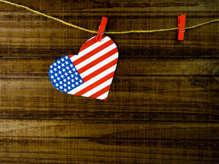 Flag of United States of America on heart shape with old vintage paper background, with clipping path - Independence Day