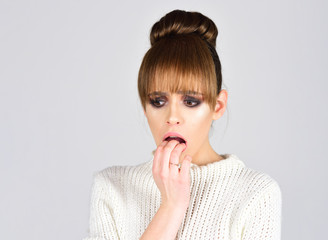 Beautiful scared woman with elegant hairstyle. Fashion photo.