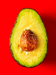 Close-up Half of an avocado on a red background