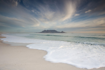 Stunning clouds over Table Mountain in Cape Town South Africa,as seen from blouberg beach, one of the top holiday destinations in the world