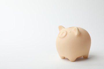 Cute piggy bank on white background. Money saving
