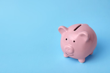 Pink piggy bank on color background. Money saving