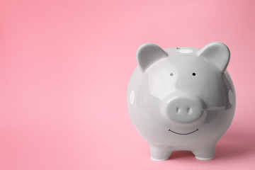 Gray piggy bank on color background. Money saving