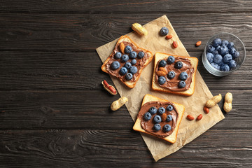 Toast bread with chocolate spread and blueberry on dark background