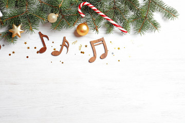 Fotobehang - Flat lay composition with decorations and  notes on wooden background. Christmas music concept