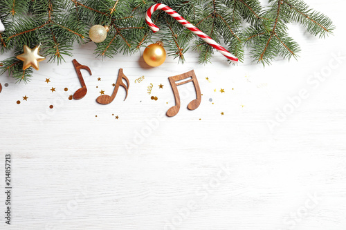 Christmas Music Background.Flat Lay Composition With Decorations And Notes On Wooden