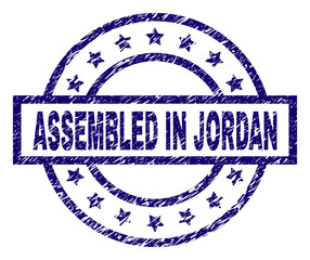 ASSEMBLED IN JORDAN seal watermark with dirty texture. Designed with rectangle, circles and stars. Blue vector rubber print of ASSEMBLED IN JORDAN caption with dirty texture.
