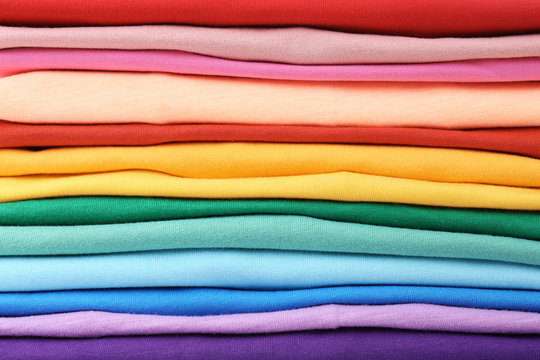 Stack of colorful t-shirts, close up view