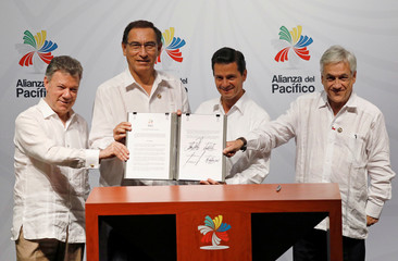Colombia's President Juan Manuel Santos, Peru's President Martin Alberto Vizcarra, Mexico's President Enrique Pena Nieto and Chile's President Sebastian Pinera pose for a picture with the final statement at the 13th Pacific Alliance Summit in Puerto Vallar