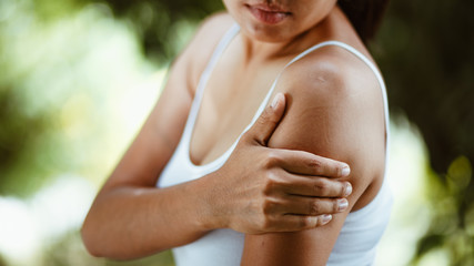 Woman with pain in shoulder and upper arm , Health Care Concept