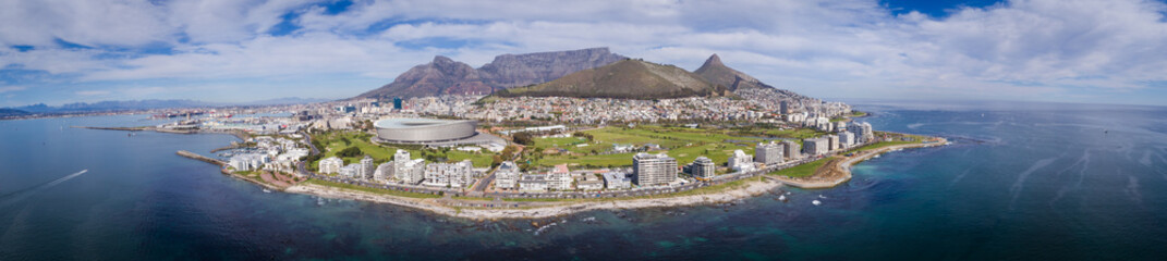 Panoramic aerial view over Cape town in south africa with Greenpoint in the foreground and Table Mountain as a backdrop