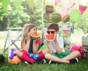 Happy Children Eating Watermelon Fruit