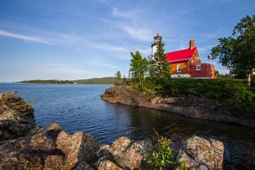 Lighthouse On A Rocky Coast. The Eagle Harbor Lighthouse on the rocky shore of Lake Superior. Eagle Harbor, Upper Peninsula, Michigan, USA.
