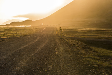 Caution Sign on Gravel Road with Golden Sunset in Stokksnes, Iceland