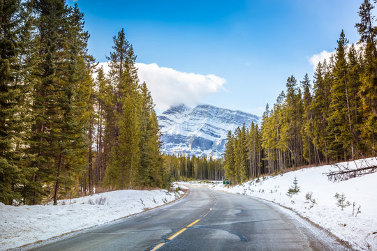 A road at Banff city, Alberta, Canada. This photo was taken during the transition between winter and snow season.