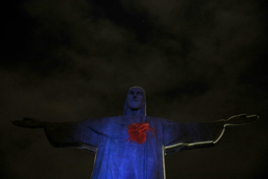 "The statue of Christ the Redeemer is lit up with a red heart to launch the campaign named ""Movement to Survive,"" to warn the elderly people who suffer diabetes about cardiovascular diseases, in Rio de Janeiro"