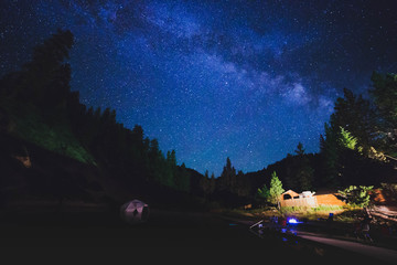 Milky Way Over Mountains, Buildings, and Pool