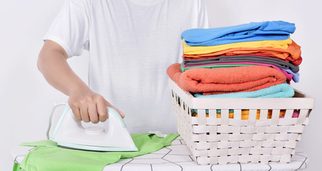 Man ironing clothes on ironing board