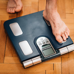 Measuring  weight using body scale