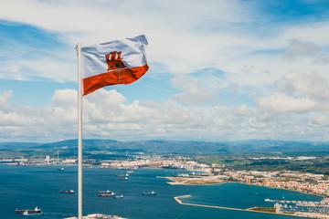 close up of Gibraltar flag waving against blue sky