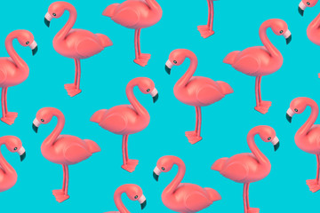 Creative pink flamingo pattern on blue background. Abstract art background. Minimal summer concept.