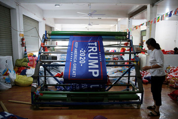 "A worker makes flags for U.S. President Donald Trump's ""Keep America Great!"" 2020 re-election campaign at Jiahao flag factory in Fuyang"