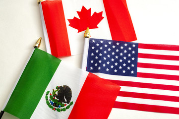 Recess Fitting Canada North American Free Trade Agreement or Nafta and 2026 football world cup organizing countries concept with close up on the flags of Mexico, USA and Canada