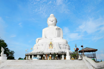 Large white statue of Buddha in Phuket, Thailand. Concept of religious landmarks and asian sculpture.