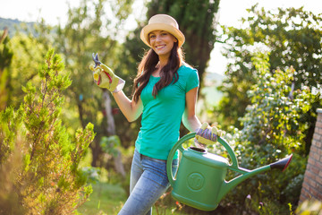 Young happy woman is ready for gardening.